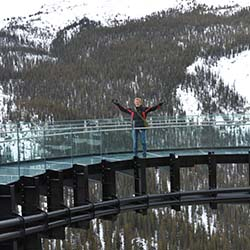 The Glacier Skywalk observation platform allows visitors to take in views from 918 feet over Jasper National Park. // ©  2014 Theresa Storm