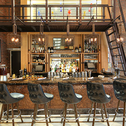 <p>Archer Hotel New York's Foyer Bar // © 2016 Archer Hotel New York</p><p>Feature image (above): Archer's guestrooms are full of luxuries, including...