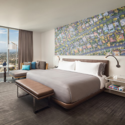 <p>Guestrooms at InterContinental Los Angeles Downtown feature headboards inspired by classic L.A. scenes. // © 2017 InterContinental Los Angeles...