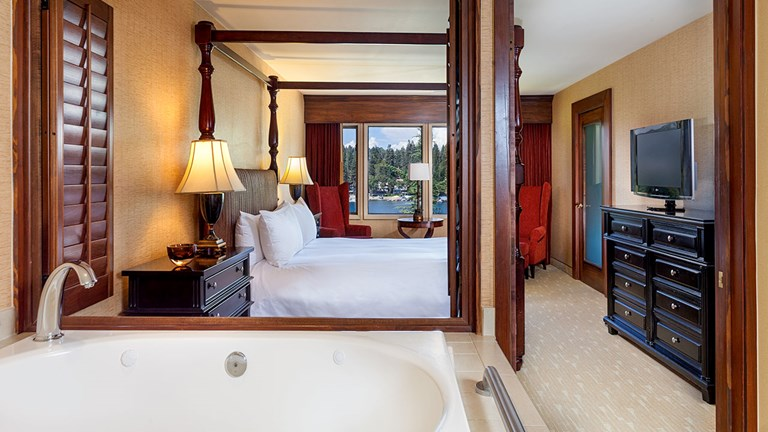 The Presidential Suite features living and dining areas, a fireplace and a soaking tub.
