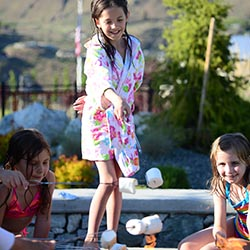 <p>Guests bond while making s'mores at The Lookout's firepit. // © 2017 The Lookout</p><p>Feature image (above): At The Lookout, cottages surround a...