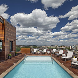 <p>Kimpton Mason & Rook Hotel's rooftop pool and bar // © 2017 Kimpton Mason & Rook Hotel</p><p>Feature image (above): The property features...