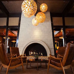 <p>The Garland's cozy lobby fireplace // © 2017 The Garland</p><p>Feature image (above): The resort pool is a great place to relax after a trip to...