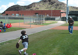 Father and son play like major leaguers at the Angel's practice facility. // (c)  Judd Eustice