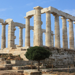 Dedicated to a sea god, the ruins of this temple overlook the Aegean. What was this temple called? // © 2013 Thinkstock