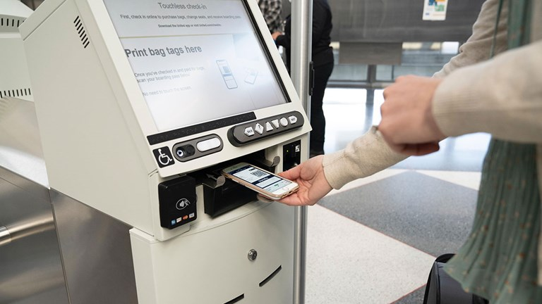United Airlines provides touchless kiosks at check-in.