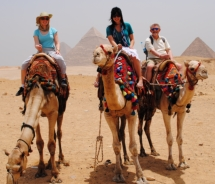 Associate Editor Skye Mayring (center) enjoys life from the top of a camel. // (c) 2010 Skye Mayring