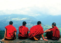 Young monks of Rumtek Monastery in the Himalayas enjoy awesome valley views. // (c) Graham Simmons