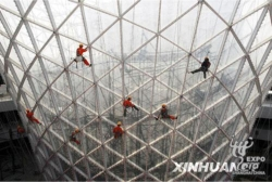 Chinese workers work on the horn-shaped 'Sunny Valley' building which lines Expo Boulevard at the World Expo site in Shanghai // (c) 2009