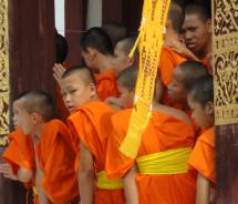 Buddhist monks and novices snap photos of the festivities. // (c) 2011 Monica Poling