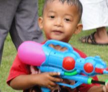 Small children look forward to Songkran all year long. // (c) 2011 Monica Poling
