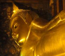 The massive reclining Buddha at the Wat Pho Temple is one of Bangkok's must-see attractions. // © 2011  Monica Poling