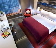 A guestroom at the Quincy // © 2010 Quincy Hotel/Far East Organization