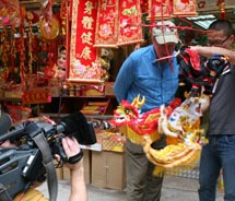 """Adventures with Purpose"" host Richard Bangs (center) filmed in Hong Kong during the Chinese New Year. // © 2010 Adventures with Purpose"