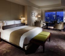 Rooms feature earth tones and state-of-the-art electronics. // © 2012 Palace Hotel Tokyo
