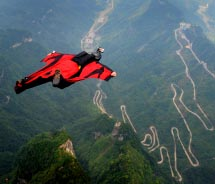 Wingsuit contestant Joby Ogwyn free falling above Zhangjiajie National Park // © 2013 World Wingsuit League