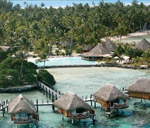 The overwater bungalows at Manihi Pearl Beach Resort // © 2010 Manihi Pearl Beach Resort