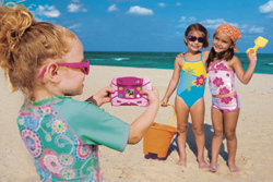 Kids play with a Fisher-Price Kid Tough Digital Camera on the beach.  // (c) Fisher-Price