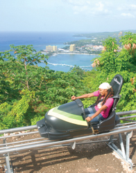 Visitors careen down the tracks of the bobsled run at Mystic Mountain in Ocho Rios. // (c) David Swanson