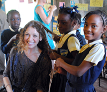 Assistant Editor Mindy Poder takes a break from reading with the new friends she met on The Reading Road Trip, the first voluntourism opportunity...