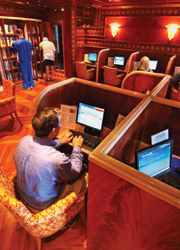 Onboard the Carnival Miracle, clients can check in with friends and family in the Raven Library. // (c) Carnival Cruise Line