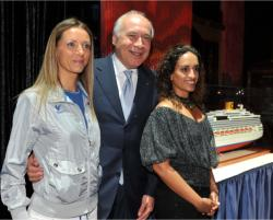 Costa Crociere chairman and CEO Pier Luigi Foschi is flanked by the line's two godmothers // (c) 2009