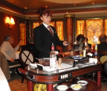 The Princess Grill maitre d' serves up a flaming cherries jubilee // (c) 2011 Monica Poling