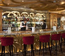 Rhapsody's Champagne Bar will re-emerge as the R Bar, featuring a 1960's look and feel. // © 2012 Royal Caribbean International