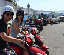 The writer (right) takes a scenic drive around Mykonos, Greece, this summer. // © 2012 Skye Mayring