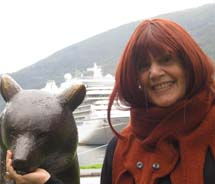Cruise Editor Marilyn Green stands in front of Oceania Marina in Flam, Norway. // © 2012 Marilyn Green