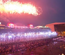 As pyrotechnics light the sky, the Disney Dream cruise ship makes its first public appearance Oct. 30, 2010 in Papenburg, Germany. Thousands of local...