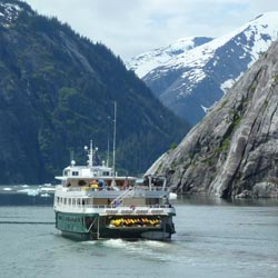 Discoverer cruising the Tracy Arm, a fjord in Alaska near Juneau. // (C) 2013 Un-Cruise/PKnego