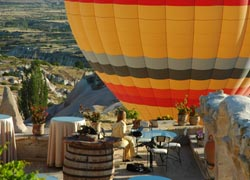 A hot-air balloon rises over the Museum Hotel in Cappadocia, Turkey. // (C) 2010 Museum Hotel Cappadocia