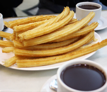 Chocolateria San Gines serves churros — long, lightly oiled, crispy fried dough straight from the kitchen to the table — with thick hot chocolate. // © 2011 Mindy Poder