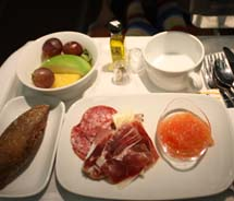 An afternoon snack of Iberico ham, fresh fruit, tomato and fresh bread given to Business Plus passengers on Iberia Airlines // © 2011 Mindy Poder