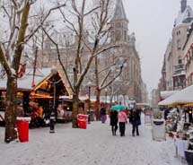 Snow falls on the Luxembourg Christmas market. // © 2011 Pride Travel / Nathan DePetris