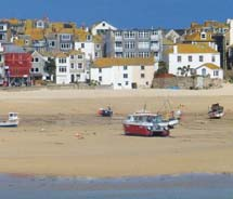 In charming St. Ives, the tide retreats beyond the harbor, leaving boats to sit on the sand awaiting its return at the end of the day. // © 2012...