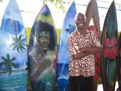 Surfboard artist Ron Artis in front of his painted boards. // (c) Kathy Leong