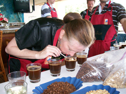 Woman sniffing coffee at a cupping competition during Kona Coffee Cultural Festival. // (c) Kona Coffee Cultural Festival