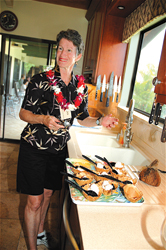 Chef Ann Sutherland in the kitchen during a Home Tours Hawaii outing on the Big Island // (c) Fern Gavelek