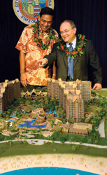Walt Disney Parks & Resorts chairman Jay Rasulo (right) shared plans for its future resort in Hawaii with Honolulu mayor Mufi Hannemann. // (c) Walt Disney Parks & Resorts