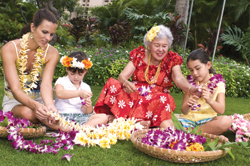 Lei making is a simple and easy way to include members of the family from all generations. // (c) Hilton Family Hawaii
