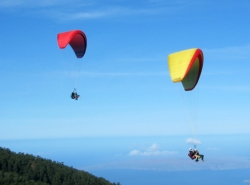 Two pairs of tandem paragliders above Maui // (c) Proflyght Paragliding 2009