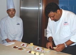 Halekulani executive chef Vikram Garg preparing a meal in the Orchid Suite // © 2010 Ken Shapiro
