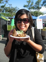 Rebecca covets a delicious kalua pork slider. // © Deanna Ting 2010
