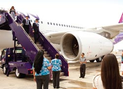 Hawaiian Airlines lands its new Airbus A330 at Honolulu International Airport. // © 2010 Dana Edmunds