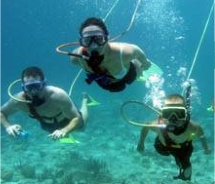 Three people underwater doing snuba // © 2010 Trilogy Ocean Sports