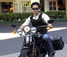On Hawaii Five-0, Chin Ho Kelly (played by Daniel Dae Kim) rides his motorcycle in the Hilton Hawaiian Village porte cochere. // © 2011 CBS