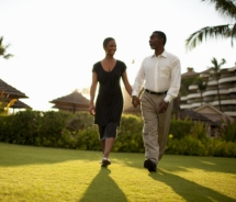 Couple walking on lawn, Sheraton Maui Resort and Spa // © 2011 Sheraton Maui Resort and Spa