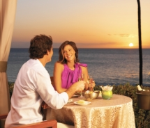 Couple dining outdoors at sunset, Westin Maui. // © 2011 Starwood Hotels & Resorts